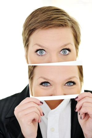 sense of space: Female eye on card surprise concept Stock Photo