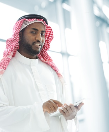 Arabic business man with tablet at office Stock Photo - 18540932