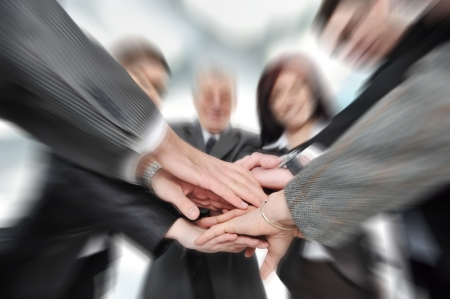 Group of business people with hands together photo