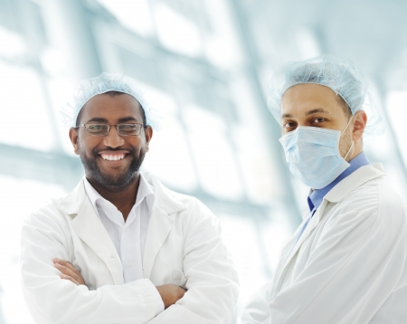 health facilities: Working people with white uniforms in modern facility Stock Photo