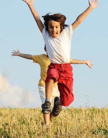children running: Two kids on field running