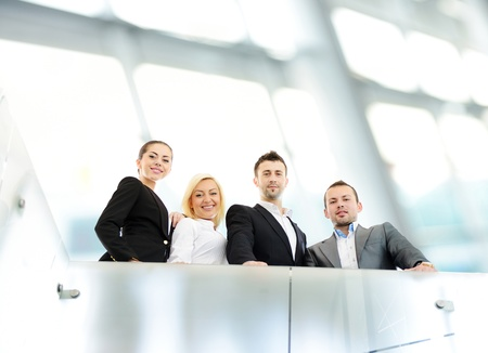 Successful business people on railing photo