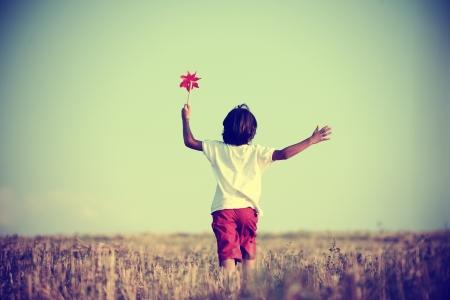 air jump: Kid in nature walking Stock Photo