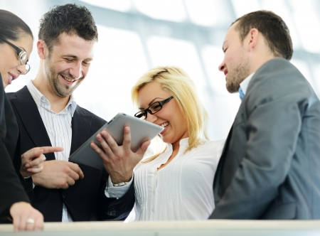 Business people using tablet computer Stock Photo - 18541910