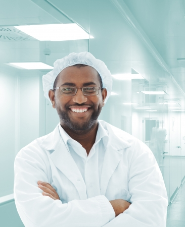 research facilities: Working people with white uniforms in modern facility Stock Photo