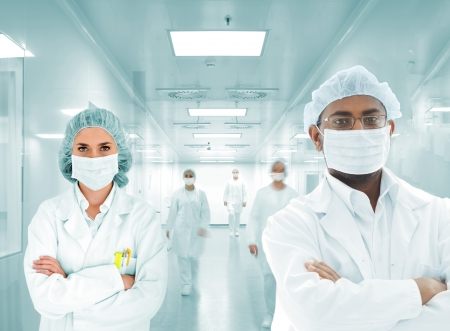 pharmaceutical industry: Scientists arabic team at modern hospital lab, group of doctors