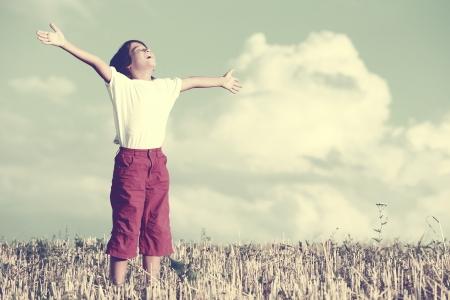 arms in air: Happy kid breathing fresh air Stock Photo