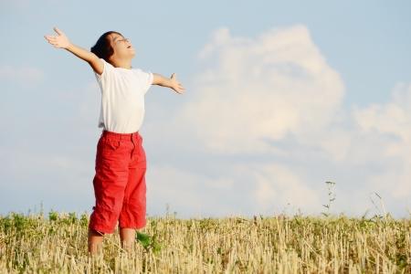Happy kid on beautiful field