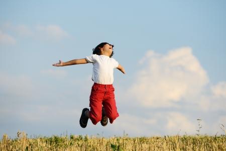 wide open spaces: Happy kid on beautiful field