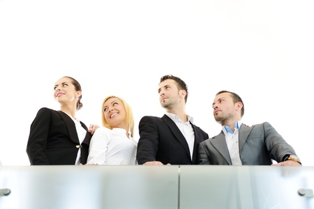 businessteam: Successful business people on railing Stock Photo