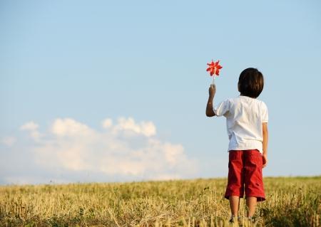 Kid on field photo