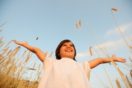 wide open spaces: Kid at wheat field with open arms
