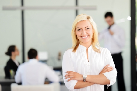 office environment: Blonde business woman in office Stock Photo
