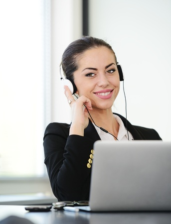 Successful business woman with headset Stock Photo - 18541633