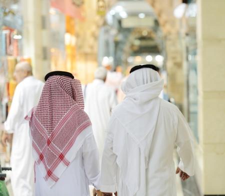 back alley: People walking on Arabic market street