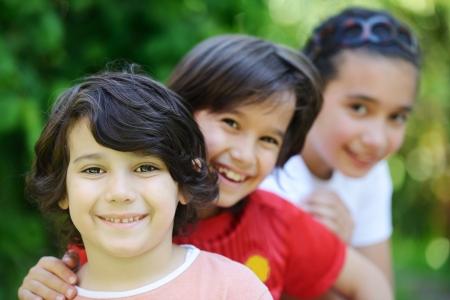 happy children: Group of happy children outside