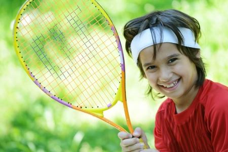 Kid playing tennis Stock Photo