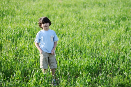 Kid on meadow photo