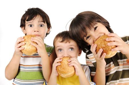 kids eating: Three kids eating burgers