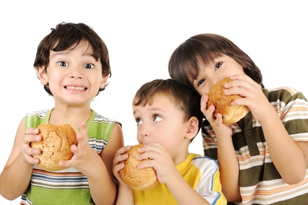Three kids eating burgers photo