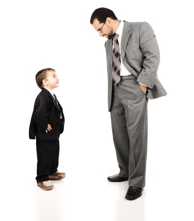 oversized: Young father and his son wearing suits Stock Photo