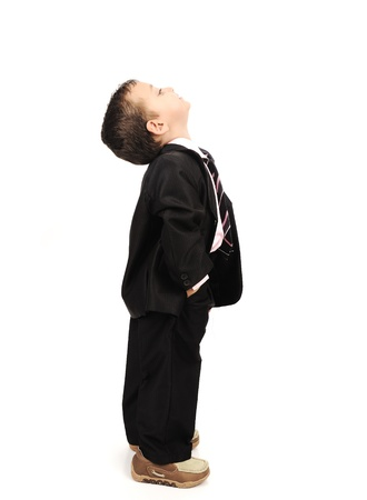 Kid wearing suit isolated looking up photo