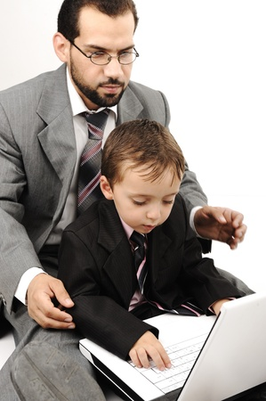 Portrait of a happy young man and his son working on laptop Stock Photo - 18540986