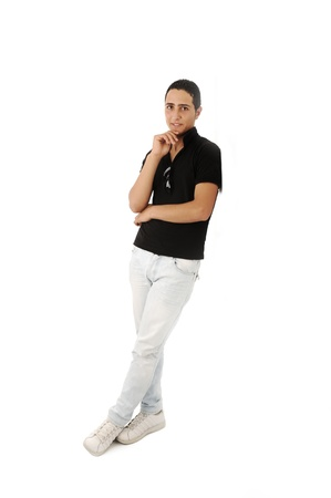Serious arabic guy standing against the wall isolated photo