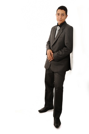 Well dressed man leaning against the wall Stock Photo - 18540829