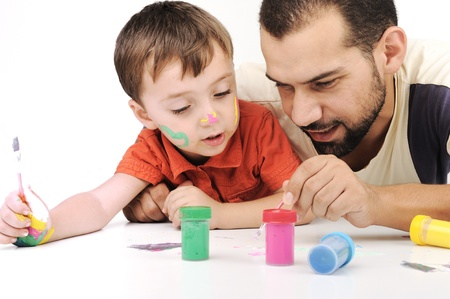 family baby: Father and kid playing with paint colors Stock Photo