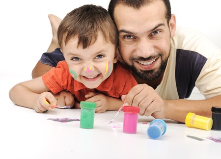 family activities: Father and kid playing with paint colors Stock Photo