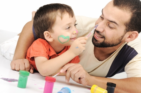 one family: Father and kid playing with paint colors Stock Photo