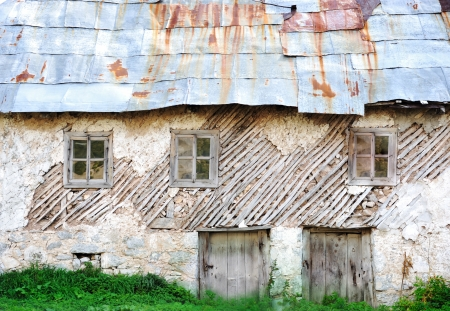 Old house in mountain village photo
