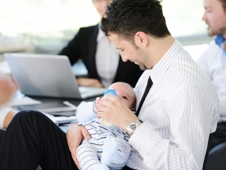 Business people taking care of baby in office Stock Photo - 18853877