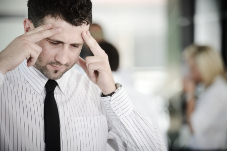 Business people with stress and worries in office photo