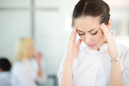 worries: Business people with stress and worries in office