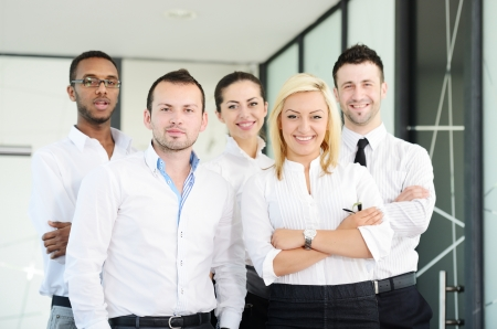 Business portrait - Happy multi ethnic executives standing together photo