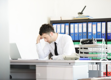 economic depression: Businessman having stress in the office
