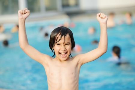 boy muscles: Little happy boy on pool Stock Photo