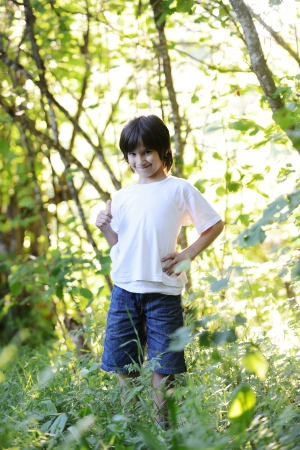 Kid standing in nature photo
