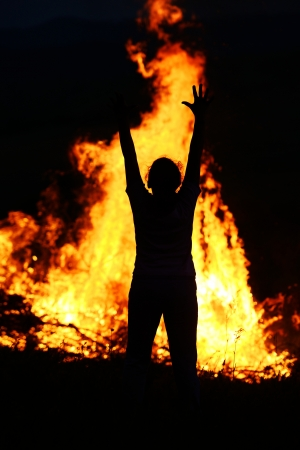 Child on fire with wide open arms photo