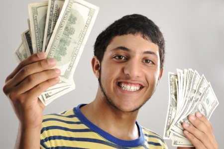 hysterical: Young man holding money dollars