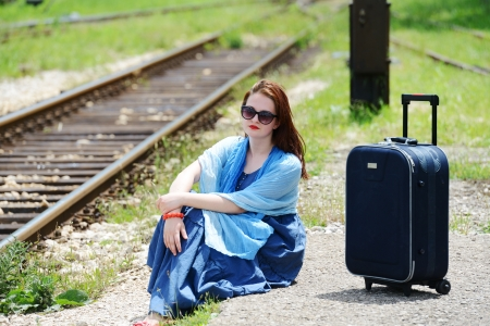 Woman siting and waiting for train photo