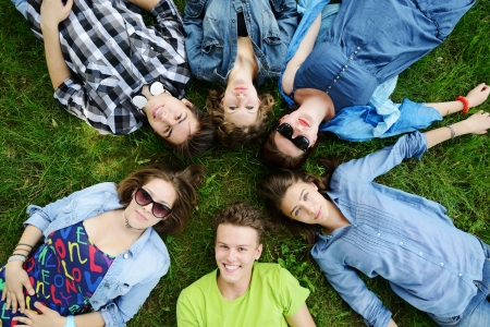 Group of friends lying on meadow photo