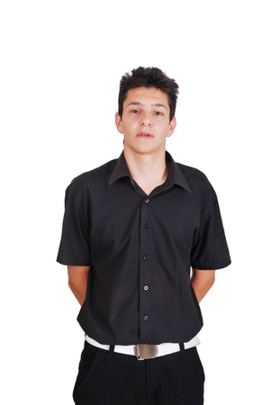 hands behind back: Young well dressed teenager standing in front of camera with his hands behind his back