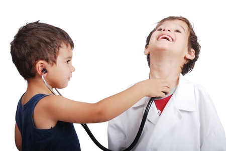 Doctor kid examining pulse to other kid photo