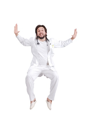 Happy male nurse or doctor full of happiness jumping photo