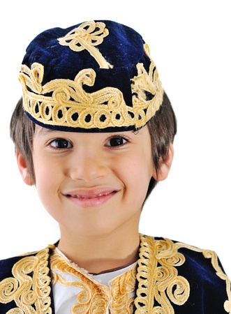 Beautiful little kid wearing bosnian traditional clothes and hat photo