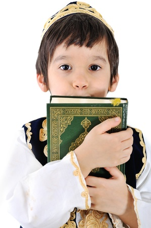 Muslim kid with holy Quran photo