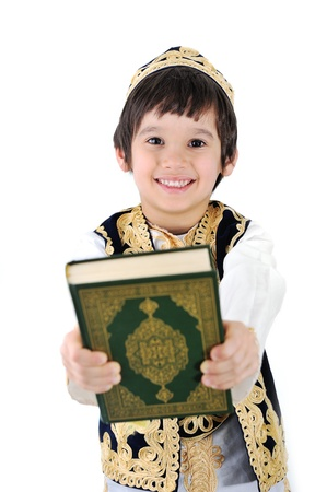 quran: Happy muslim kid holding holy Quran Stock Photo